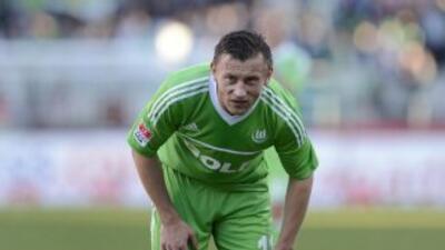 Ivica Olic hizo uno de los goles para clasificar al Wolfburgo.