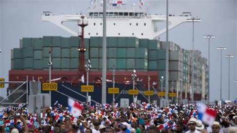 Thousands of spectators watch as the Neopanamax cargo ship, Cosco Shippi...