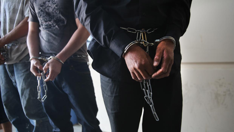 Imagen de archivo de personas arrestadas.