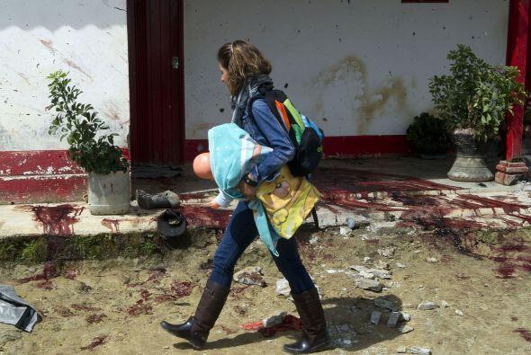 Los campesinos fueron asesinados con armas de fuego y una granada por tr...