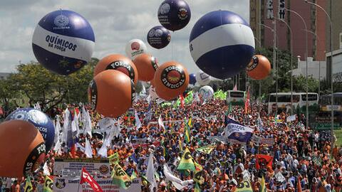 Demonstrators take part in a protest against Brazil's President Michel T...
