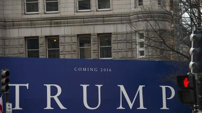 A Trump sign is seen near the Old Post Office Building, close to the Whi...