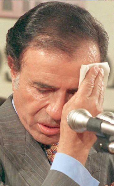 l ex presidente no se le pudo fotografiar sentado en el banquillo de los...