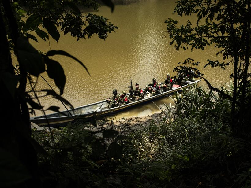 An ELN patrol in one of the thousands of rivers that run through the tro...