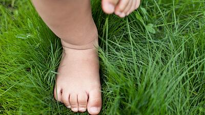 Baby walking on grass