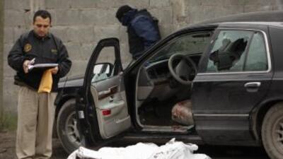 Cuatro policías municipales fueron asesinados por un grupo de sicarios e...
