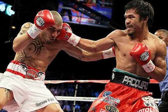 La pelea fue dominada casi de principio a fin por Pacquiao, quien impuso...