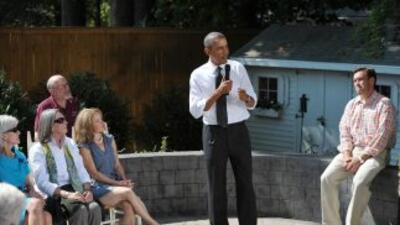 El presidente Obama visitó una familia en Falls Church, Virginia, donde...