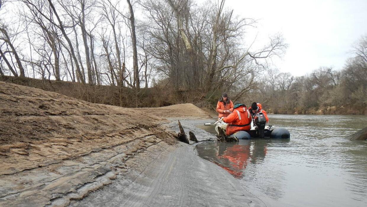 Taking core samples at the site of a coal ash spill on the Dan River in...