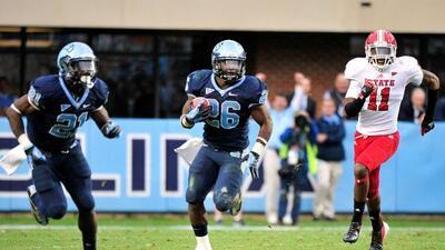 Jugadores como Giovani Bernard (#26 de North Carolina) tienen ya familia...