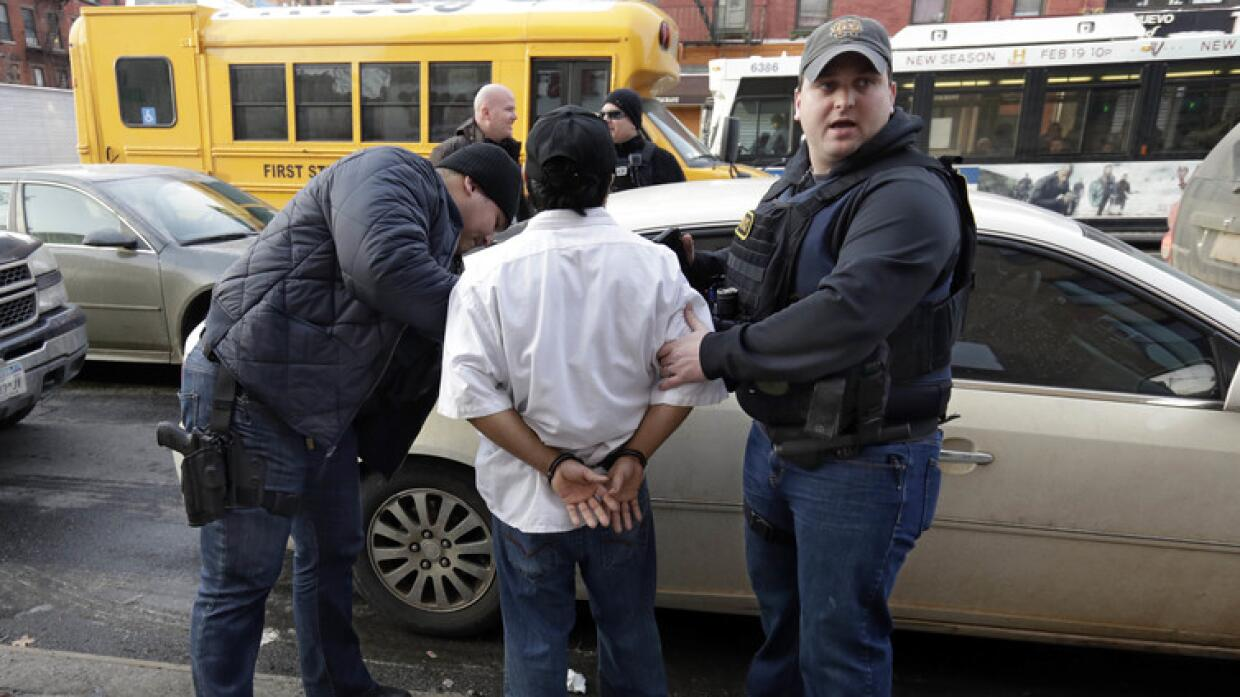 ICE officers make an arrest in New York City in 2015.