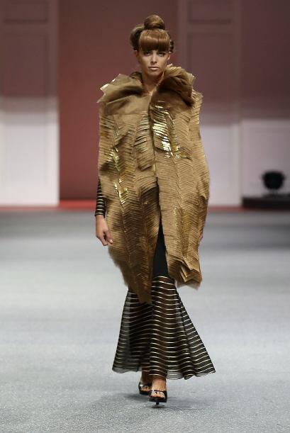 Un abrigo o 'trench' en esta tonalidad hará que estés en tendencia y pod...