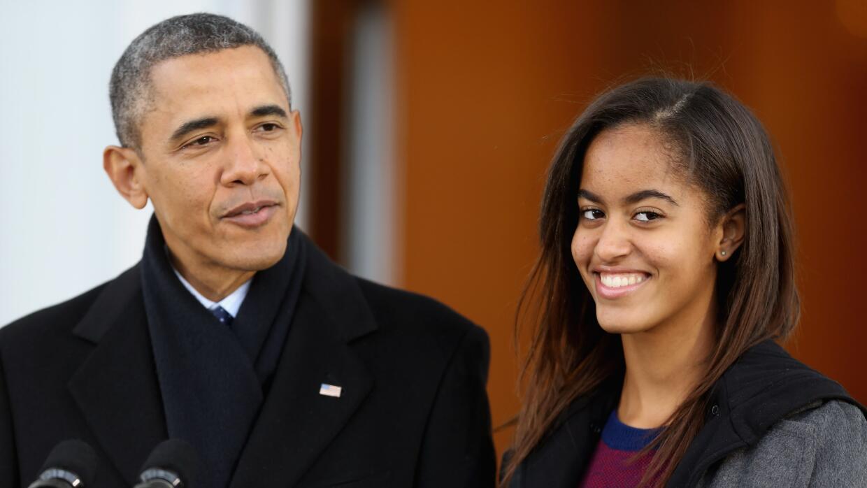 Malia Obama y Barack Obama