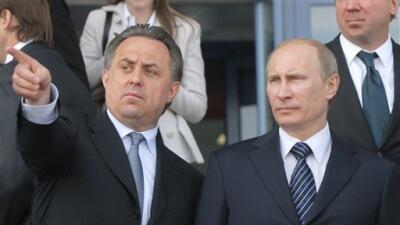 Vladimir Putin y el ministro de deportes Vitaly Mutko.