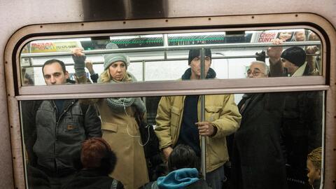 Passengers travel in the New York City subway