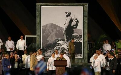 Cuban President Raul Castro speaks at a tribute to his brother and late...