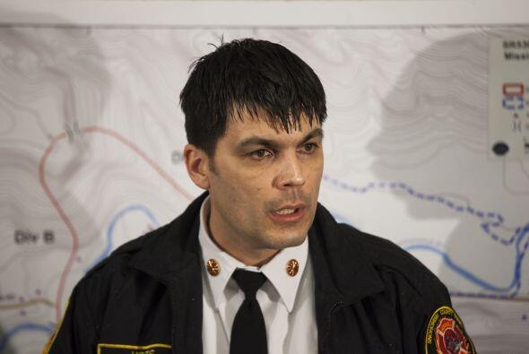 El jefe de bomberos del distrito 21 del condado, Travis Hots, expres&oac...