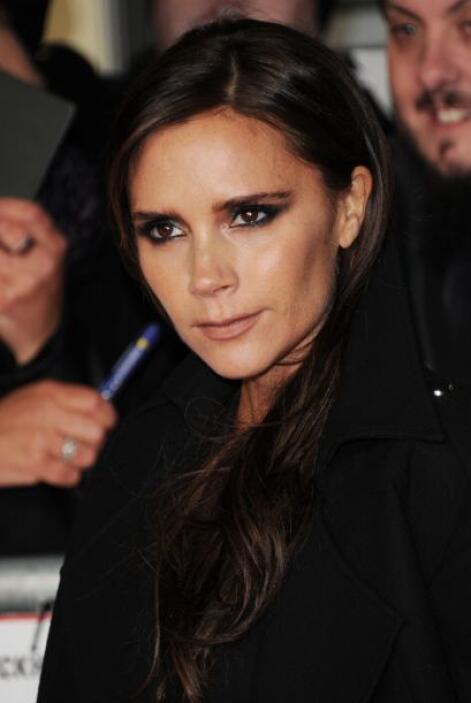 Victoria Beckham no le quitó la mirada ni un segundo a su esposo.
