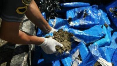 Los agentes aduanales descubrieron que entre el cargamento de ollas se e...
