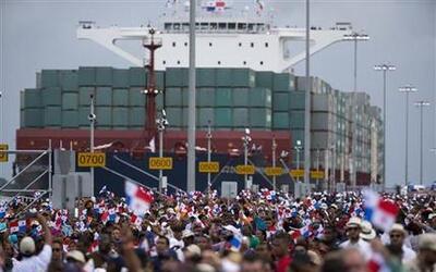 Thousands of spectators watch as the Neopanamax cargo ship, Cosco Shippi...