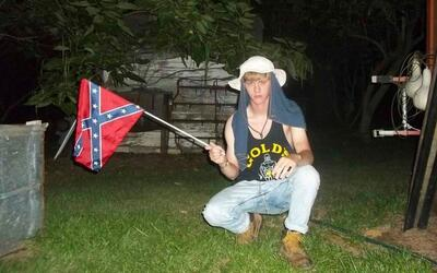 Dylann Roof with Confederate flag. One of several photos found on his Fa...