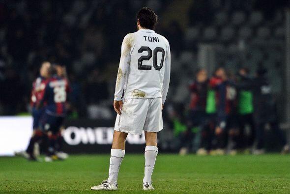 La tristeza del perdedor reflejada en la frustrada pose de Luca Toni.