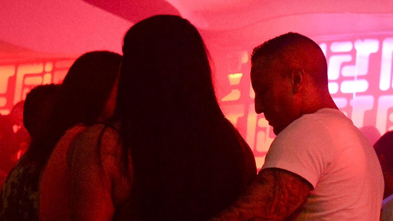 People dance reggaeton in a disco in Medellin