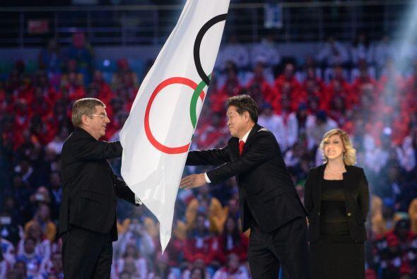 Después de la ceremonia de traspaso de la bandera olímpica...