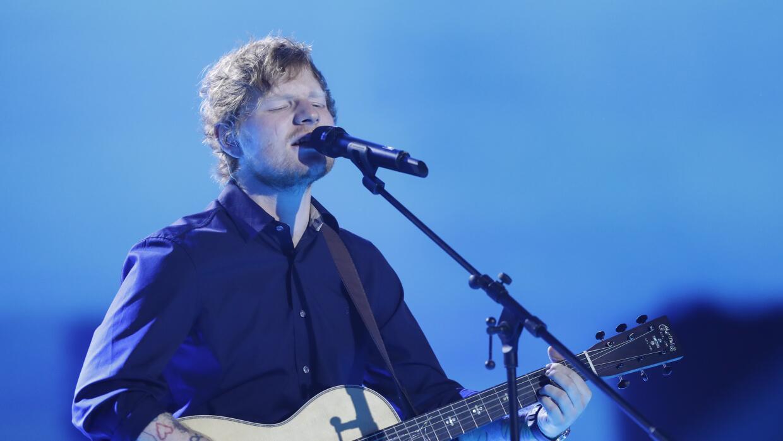 HAMBURG, GERMANY - MARCH 04: Ed Sheeran performs at the Goldene Kamera s...