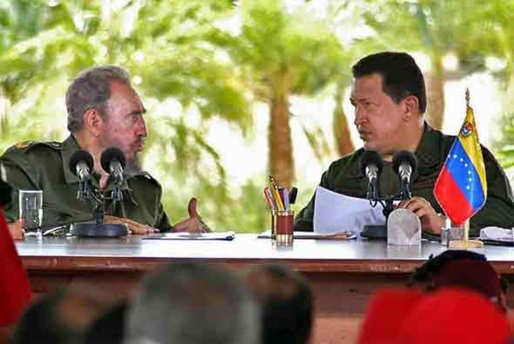 Aquí con su amigo Hugo Chávez, fallecido el pasado 5 de marzo de 2013.
