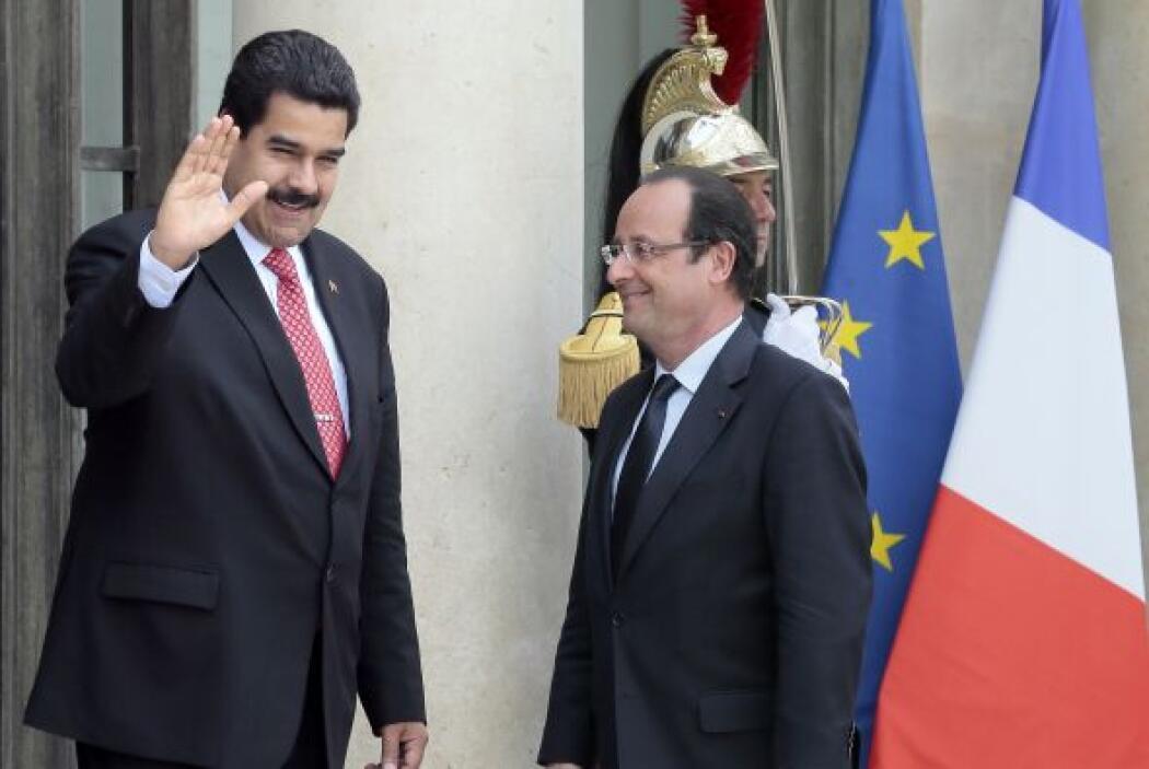 Los presidentes de Francia, François Hollande, y Venezuela, Nicolás Madu...