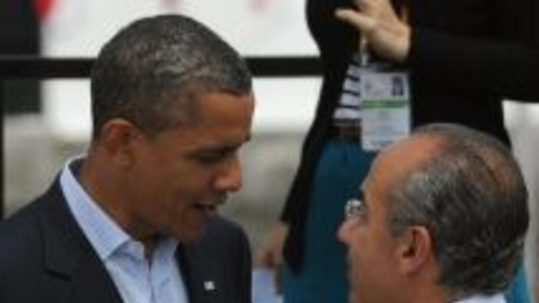 El presidente de Estados Unidos, Barack Obama, junto a su par mexicano,...