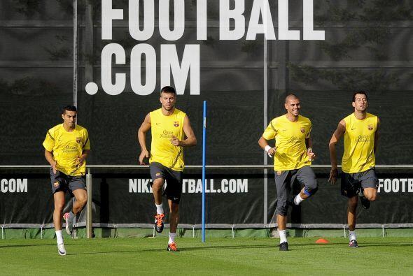 Los futbolistas comenzaron haciendo un trote lento.