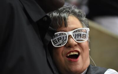 AT&T Center usher and Spurs fan Norma Ramirez (R) is greeted by a fe...