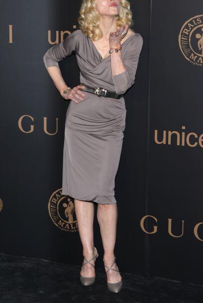 Los detalles a la cintura hacen que la atlética figura de Madonna...