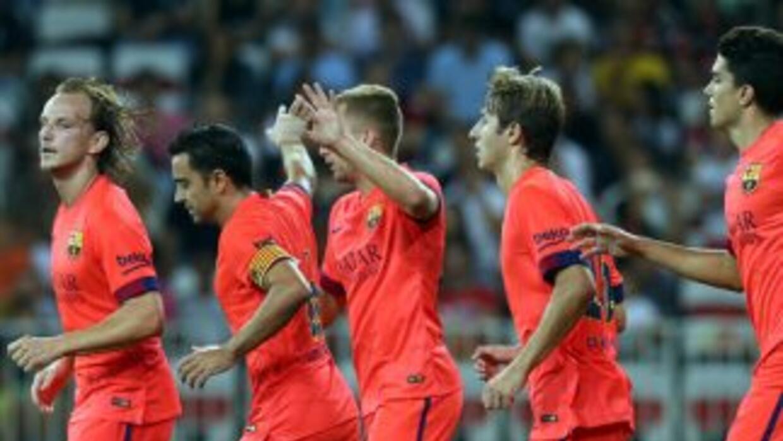 FC Barcelona festeja la anotación de Xavi ante Niza durante el juego de...