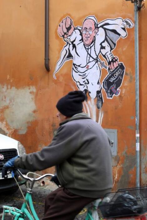 Entonces se puso a trabajar en un retrato del pontífice como un superhér...
