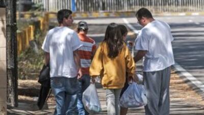 Inmigrantes salvadoreños deportados de Estados Unidos.