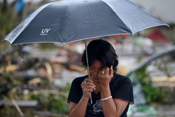 Una mujer llora frente al cuerpo de su esposo. (AFP/Getty)