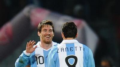Lionel y el 'Pupi' durante un partido con la selección argentina.