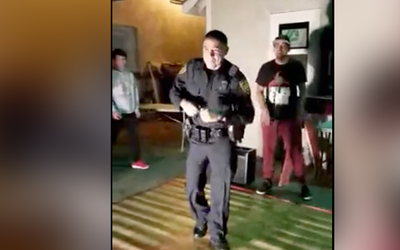 San Antonio Police Officer dances to salsa