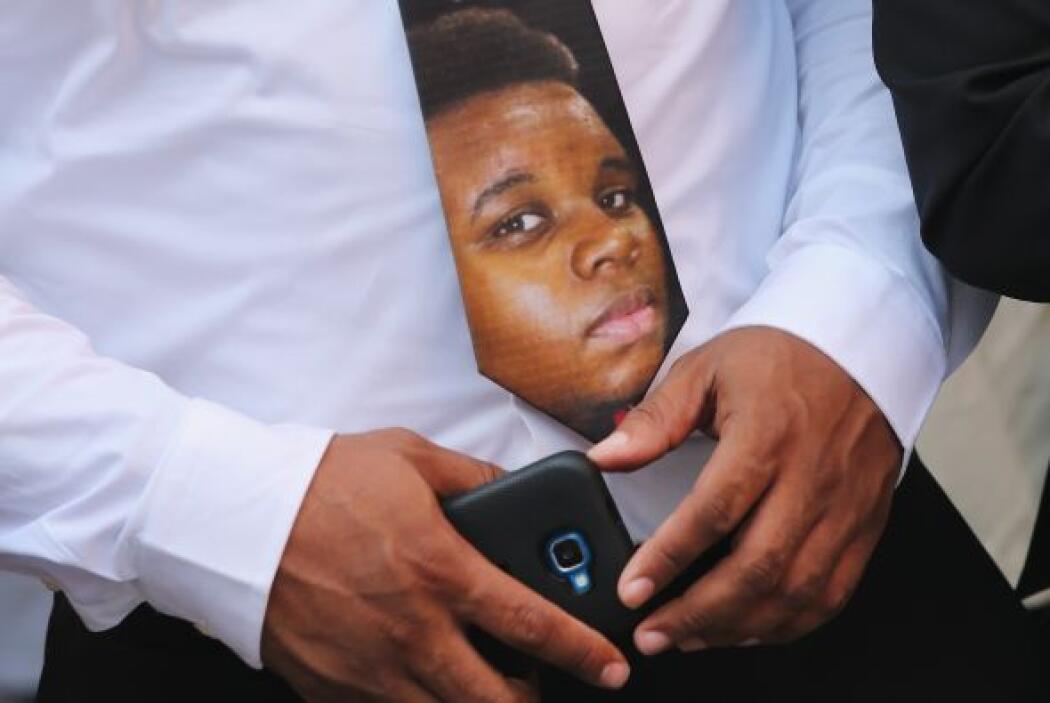 El rostro de Brown se podía ver incluso en las corbatas de algunos asist...