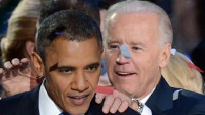 El presidente Barack Obama y el vicepresidente Joe Biden celebran la ree...