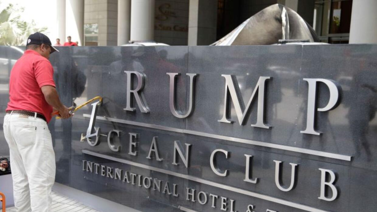 The Trump name comes off a sign at the entrance to the Trump Ocean Club...