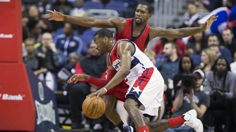 John Wall de Wizards enfrenta a Toney Douglas de Pelicans.