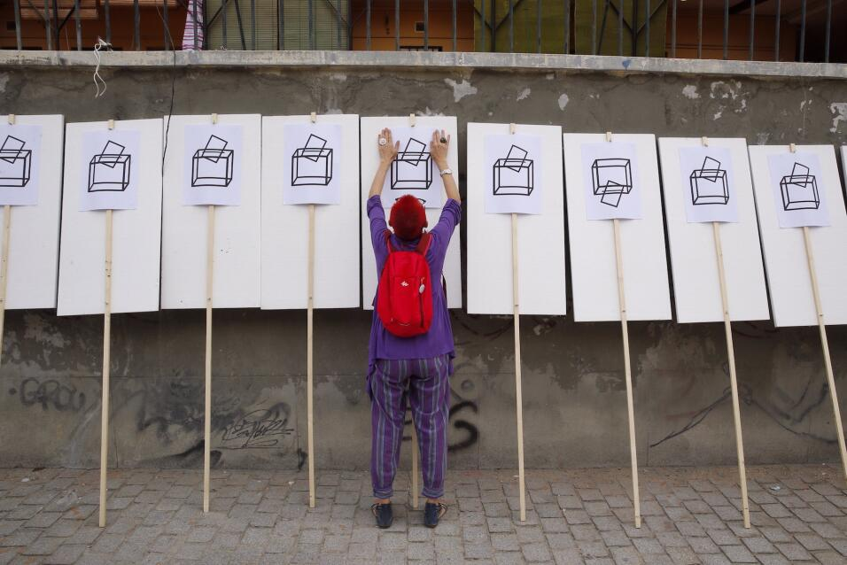 """Partidarios por el """"derecho a decidir"""" en un acto en Madrid."""