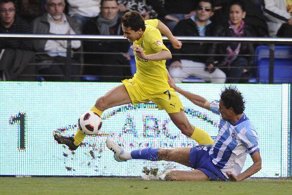El Villarreal intentaba tener la posesión de la pelota, pero los malague...