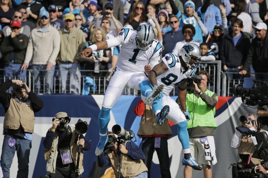 Cam Newton llevó a sus Panthers a mantenerse invictos al superar a los T...