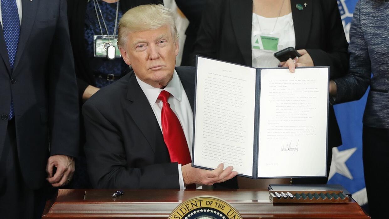 Donald Trump signing executive orders to build wall and increase border...