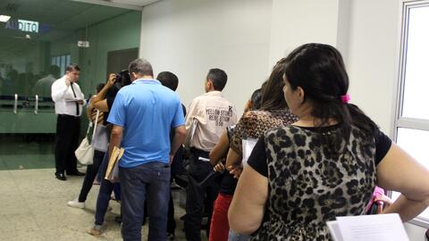 Long lines of people waiting for legal aid at the Goiânia Public Defende...